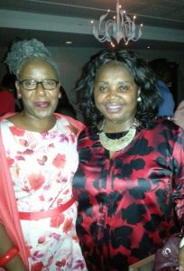 'L-R: Iyamide and Comfort at the Nostalgia Nights 'Wear Something Red' Xmas Party in December 2015